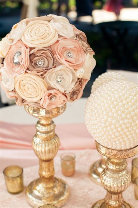 Lace and pearls themed wedding centerpieces and