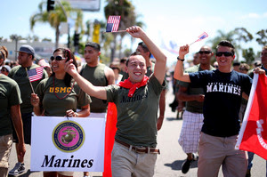 "Marines and other military personnel march in San Diego's gay pride parade on Saturday. About 200 active-duty troops and veterans from every branch of the military participated for the first time in the march since Congress voted to repeal ""don't ask don't tell."""