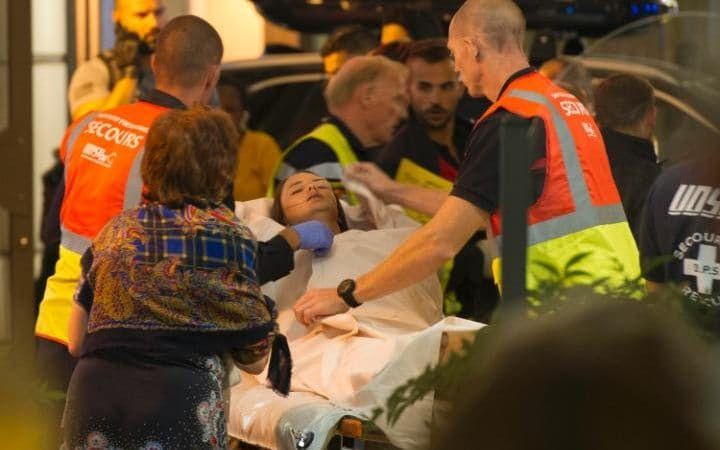 An injured woman is taken away after the attack in Nice.
