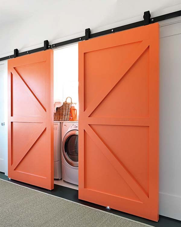Loft Ideas:  Love these orange barn door sliders for INSIDE!  Great for a loft!