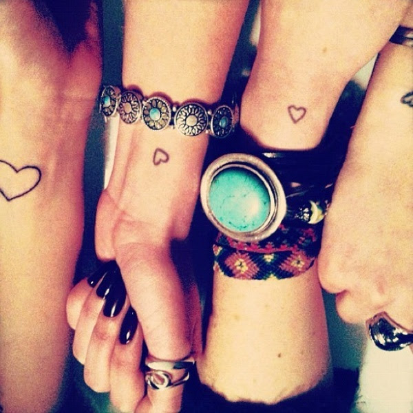 Cute jewelry and tiny heart tattoos accessorize