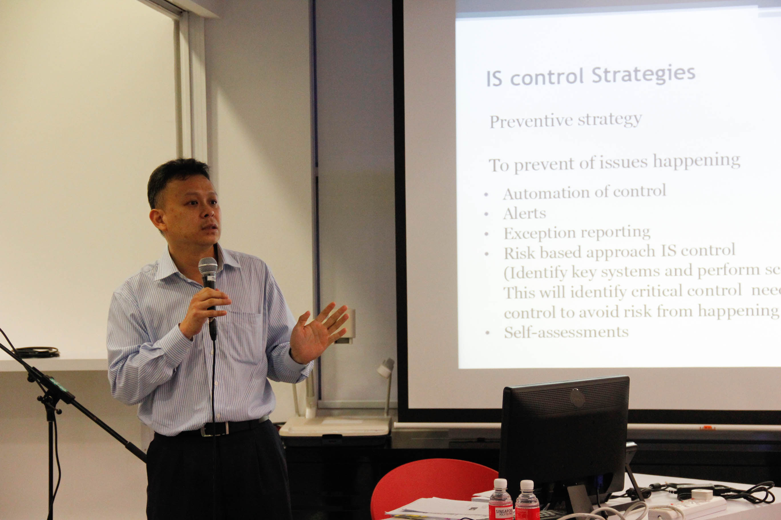 Mr Ho explaining on more details about Information System Control Strategies