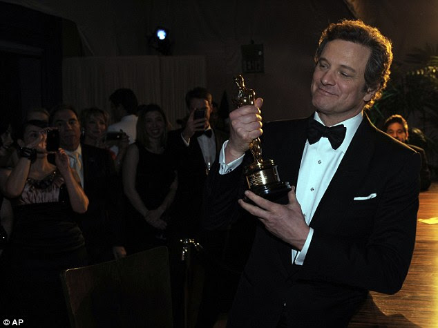 Best Actor winner Colin First holds up his award at the Governors Ball following the 83rd Academy Awards