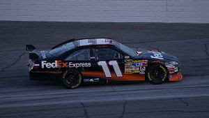Denny Hamlin celebrating after winning the sec...