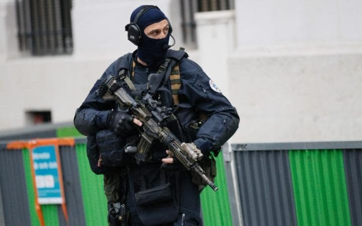 French police and members of the National Gendarmerie Intervention Group (GIGN) escort a convoy transporting a surviving member of the group that carried out Paris terror attacks suspect Salah Abdeslam to Paris courthouse for his first questioning in the French capital by anti-terror judgeson May 20, 2016 in Paris. Salah Abdeslam was part of the group that carried out Paris terror attacks on November 13, 2015 that killed 130 people.