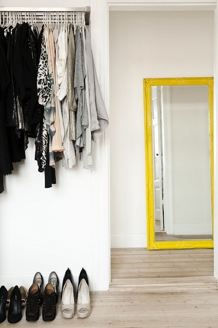 LE FASHION BLOG OPEN CLOSETS PART 2 HOME DECOR IDEAS FASHIONABLE HOME INSPIRATION CLOTHES ON DISPLAY BRIGHT YELLOW FRAMED FLOOR MIRROR SIMPLE METAL CLOTHES RACK SHOES LINED AGAINST WALL PALE WOOD FLOORS VIA PETER KRAGBELLE 3 photo LEFASHIONBLOGOPENCLOSETSPART2YELLOWMIRRORVIAPETERKRAGBELLE3.jpg