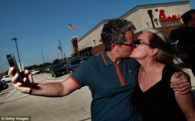 Forever love: Same sex couple Shellie Crandall and Pam Buchmeyer kiss outside a Chick-fil-A restaurant on August 3, 2012 in Dallas, Texas