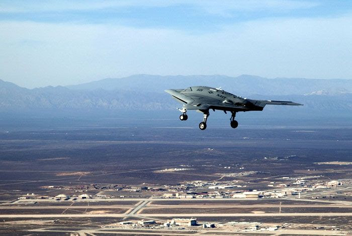 The X-47B UCAS-D drone flies above Edwards Air Force Base in California on February 4, 2011.