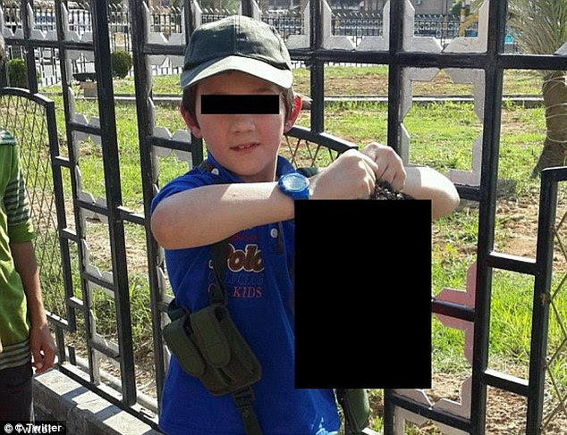 Disturbing: The disturbing photographs come just days after convicted Australian terrorist Khaled Sharrouf uploaded a image of his seven-year-old son standing in the same spot holding a decapitated head