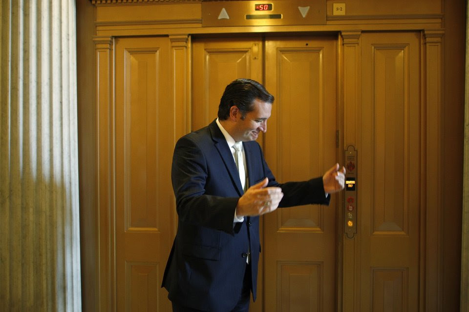 U.S. Senator Cruz reacts to a question after remarks on federal budget spending votes in Washington