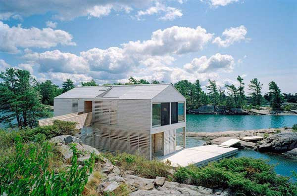 Floating-House-with-an-Integrated-Boathouse-and-Dock-1