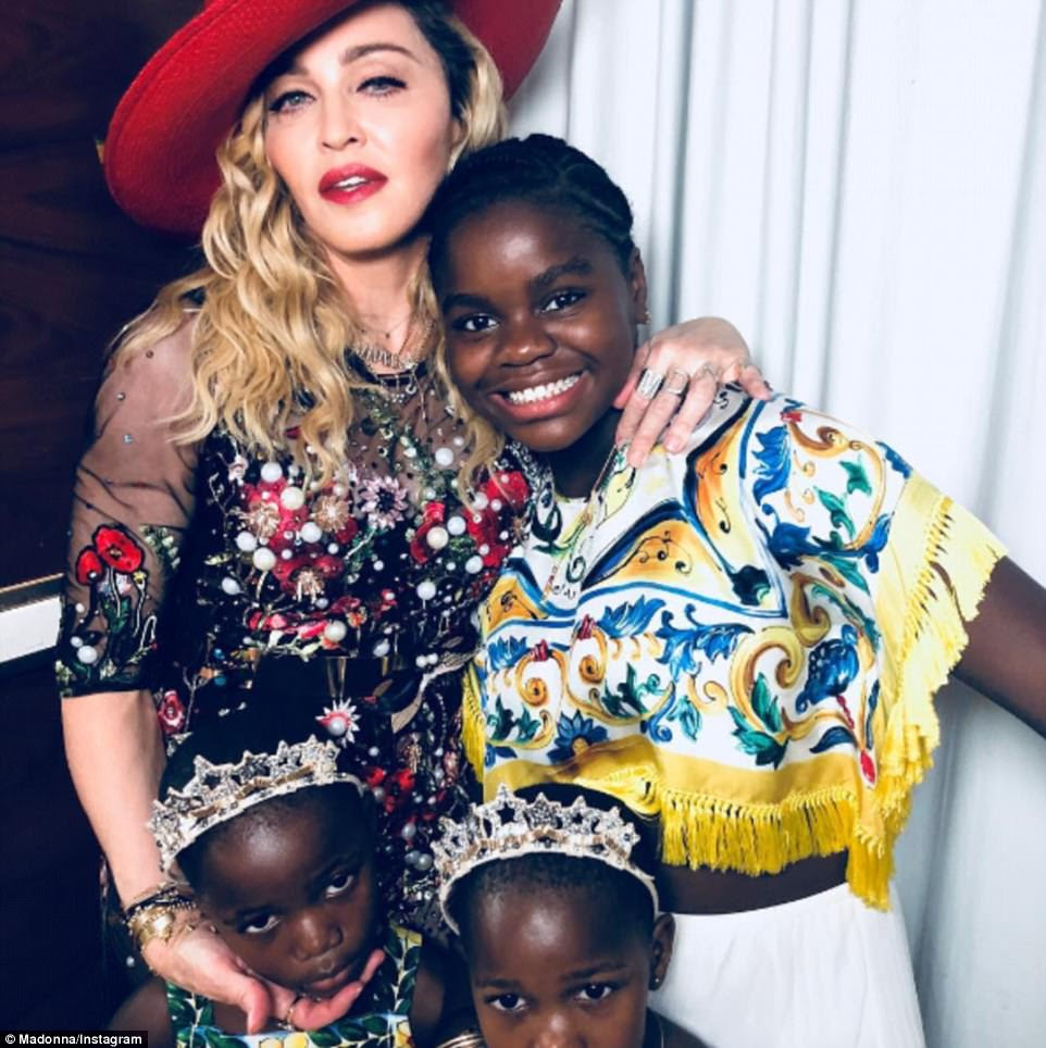 Family affair: Madonna even brought three of her kids along