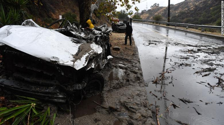 Mud fillls a street Tuesday in Burbank, California, destroying cars and damaging property.