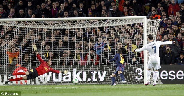 On the money: Ronaldo scored twice as Real Madrid knocked Barcelona out of the Copa del Rey on Tuesday