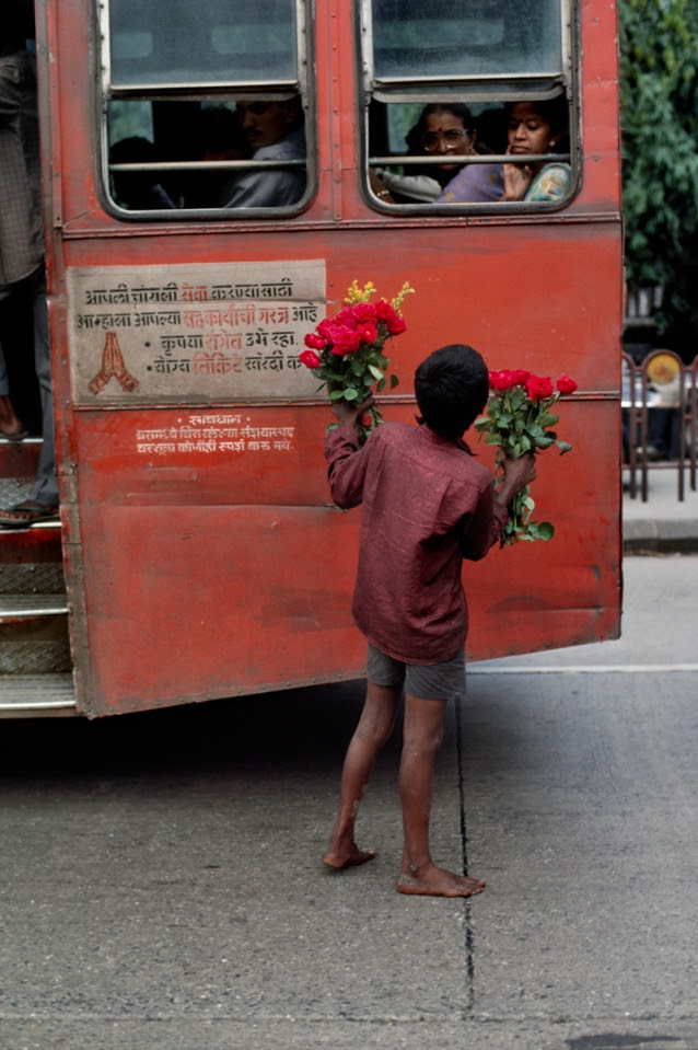 00075_15. Young Boy Selling Flowers, India, 1993