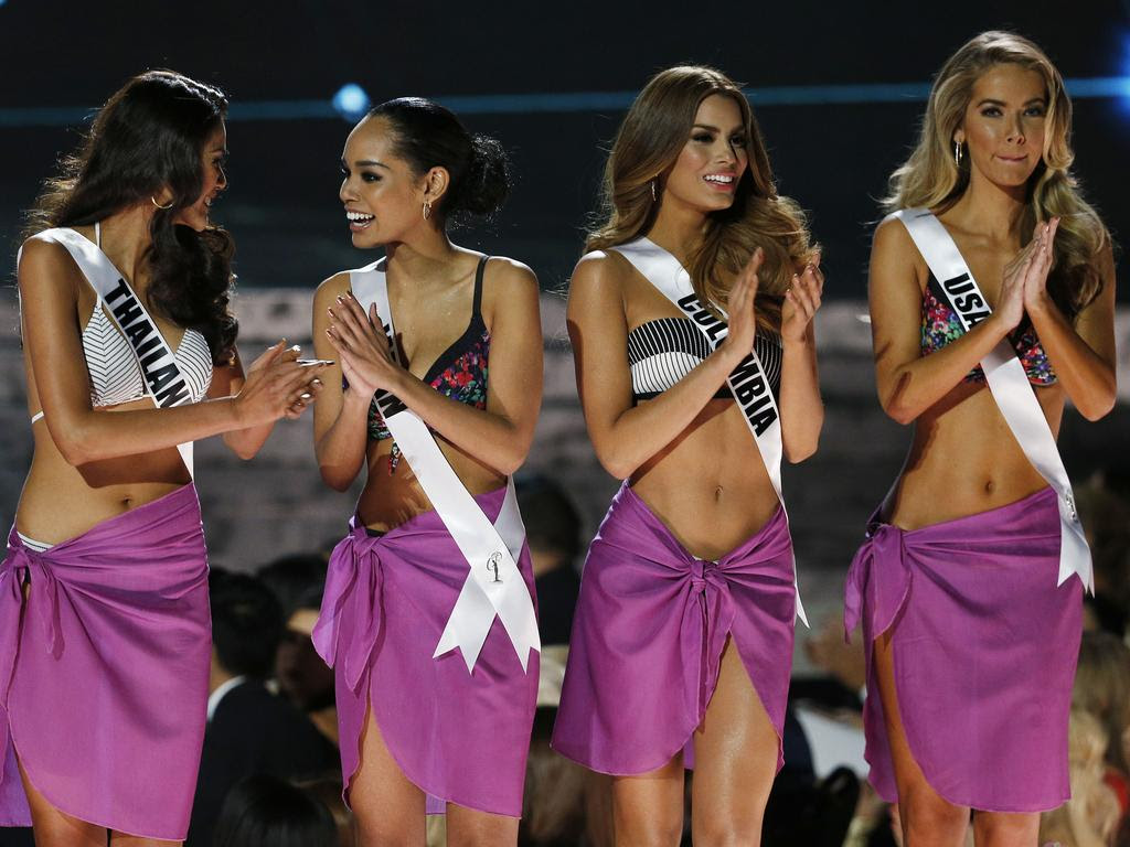 From left, Miss Thailand Aniporn Chalermburanawong, Miss Japan Ariana Miyamoto, Miss Colombia Ariadna Gutierrez and Miss USA Olivia Jordan stand on stage at the Miss Universe pageant on Sunday, Dec. 20, 2015, in Las Vegas. (AP Photo/John Locher)