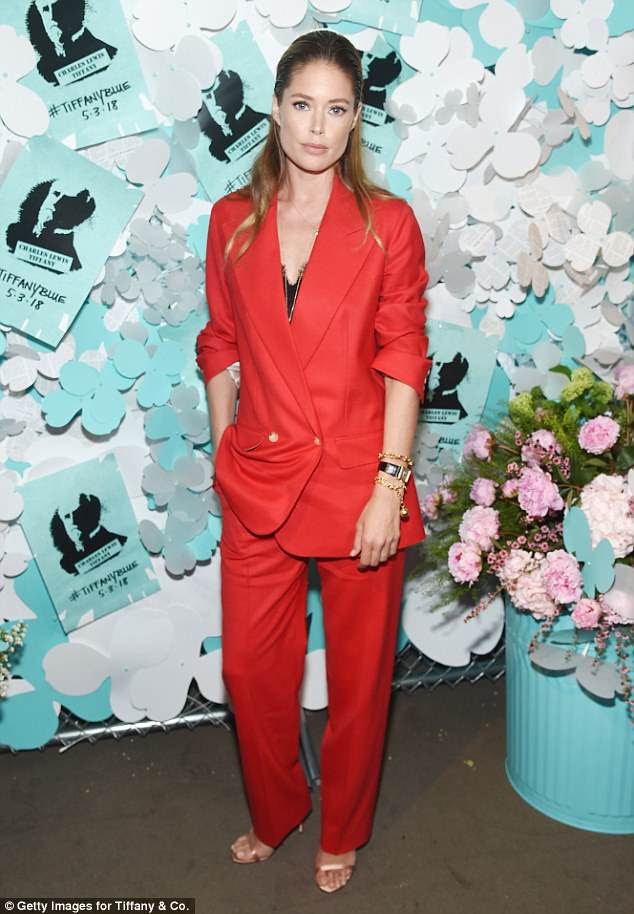Red hot: Doutzen Kroes was a scarlet sensation in a bright red suit