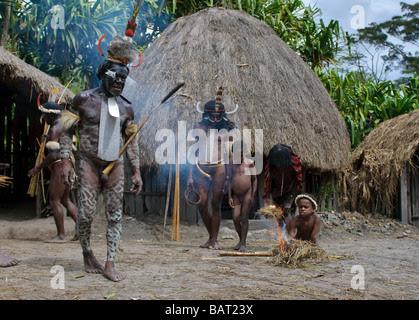 DANI VILLAGE, WAMENA, IRIAN JAYA, NEW GUINEA, INDONESIA – 25 JULY Stock Photo, Royalty Free