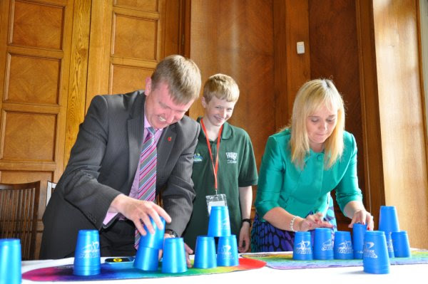 Chairperson of the Education Committee, Mervyn Storey MLA takes on Michelle McIlveen MLA, Chairperson of the Culture, Arts and Leisure Committee in a Sport Stacking race.
