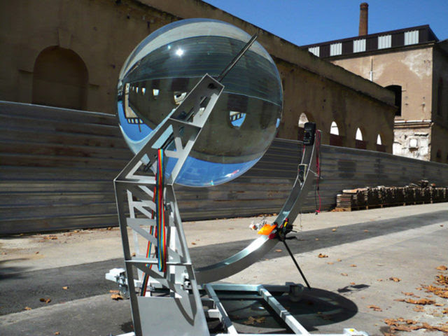 A Glass Sphere Solar Energy Generator Capable of Converting Sun and Moonlight into Usable Power sun solar power moon light glass