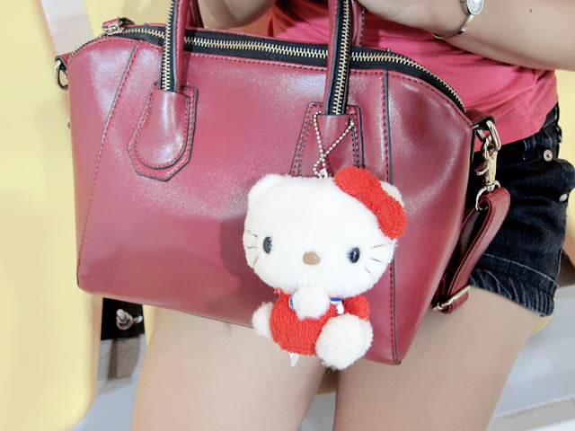 hello kitty hanging on bag