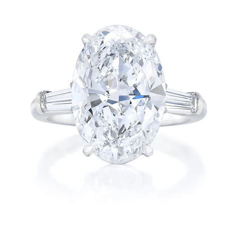 Oval Cut Tapered Baguette Side Stone Engagement Ring