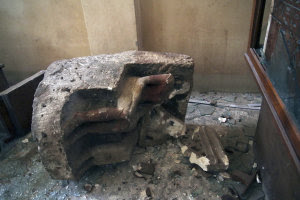 A damaged object lies on the floor of the Malawi Antiquities…
