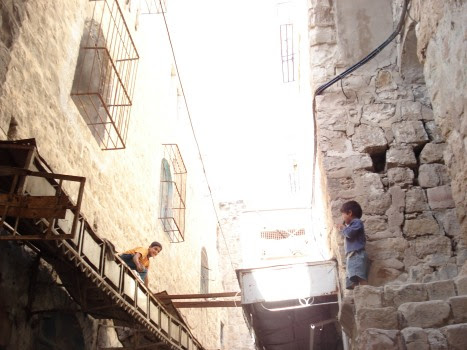 palestinian boys retrieving their ball in the old city of khalil
