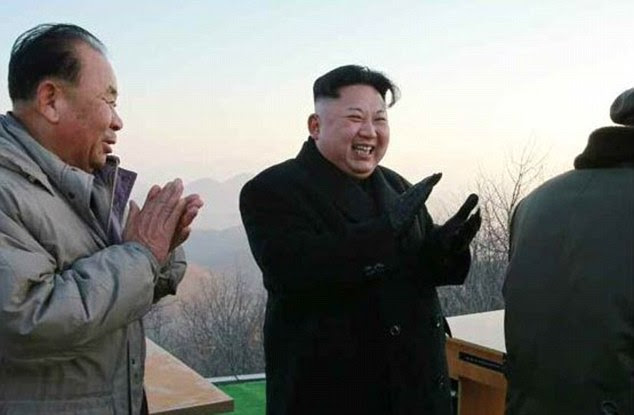 North Korea news sources showed the country's leader, Kim Jong-Un, smiling and clapping as the nuclear-armed nation launched three missiles in training for a strike on US bases in Japan