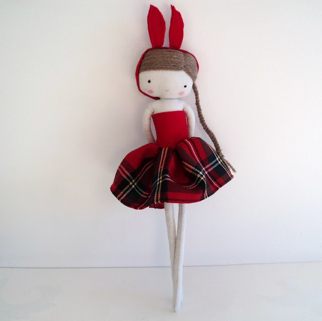 doll in red