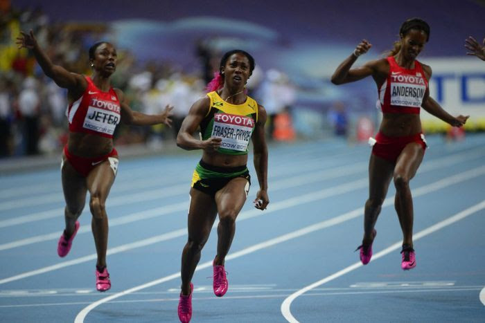 Jamaica's Shelly-Ann Fraser-Pryce (centre) wins the women's 100 metres final
