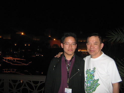 Dad and I, in front of the Madinat Arena at night