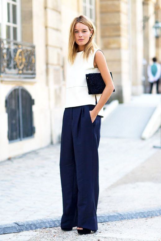 Le Fashion Blog Street Style Camille Rowe Minimal Office Look White Sleeveless Shell Top Navy Wide Leg Trousers Platform Sandals Black Clutch Via Harpers Bazaar