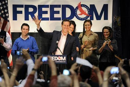 U.S. Republican presidential candidate Rick Santorum waves to supporters during his Illinois primary night rally in Gettysburg, Pennsylvania, March 20, 2012. REUTERS-Jonathan Ernst