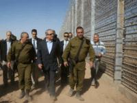 Israeli Prime Minister Benjamin Netanyahu walks with IDF Chief of Staff Gadi Eizenkott, left, as they visit the construction work on the fence between Israel and Jordan Tuesday, Feb. 9, 2016. (Marc Israel Sellem, Jerusalem Post, Pool via AP)