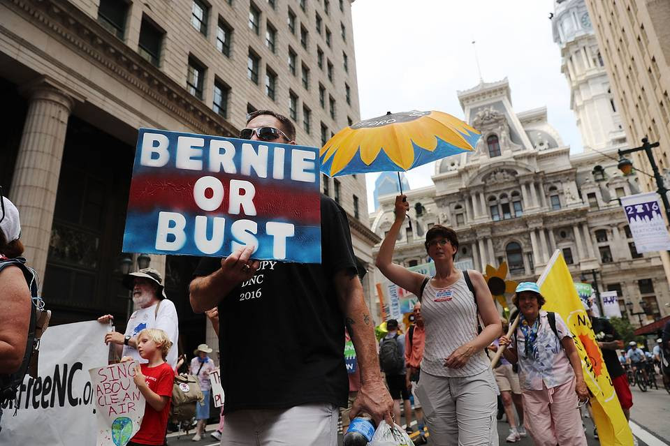 Hundreds of environmentalists and Bernie Sanders supporters march through downtown before the start of the Democratic National Convention on July 24, 2016 in Philadelphia.