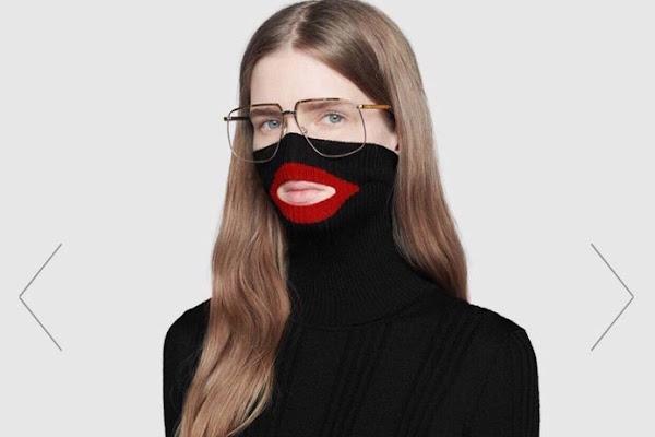 5cc606960b3 Modemerk Gucci door het stof voor ontwerp 'blackface-sweater'