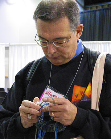 Robert Knitting a Tam, Stitches Midwest 2005