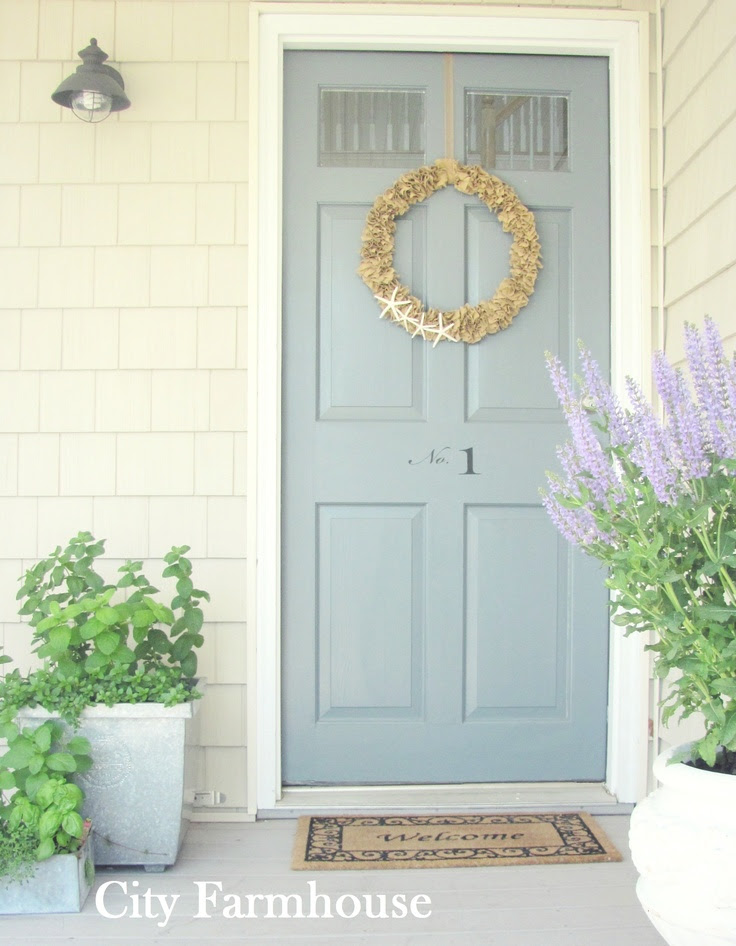 Front Door. Starfish rag wreath, number decals & zinc pots filled with mint, thyme & basil.