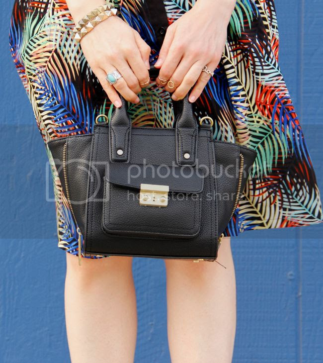 L.A. fashion blogger The Key To Chic wears a matching tropical print crop top and skirt from Sense of Style boutique with ankle strap heels and a Phillip Lim for Target mini satchel.