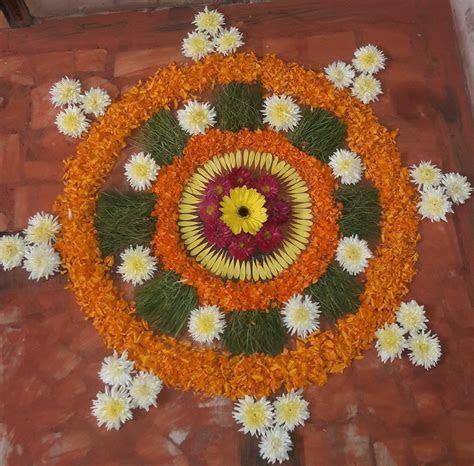 Flower rangoli   Floral arrangements   Rangoli designs