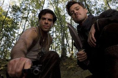 Aldo Raine and Donny Donowitz (Eli Roth) look at their gory handiwork in INGLOURIOUS BASTERDS.