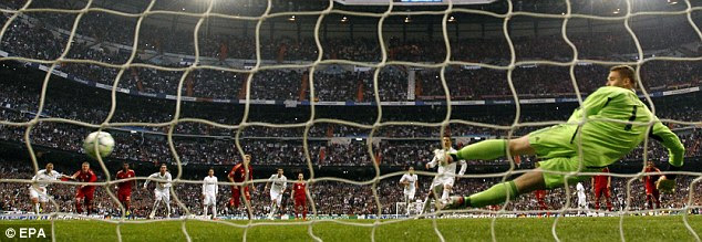 Spot on: Cristiano Ronaldo (centre) opens the scoring with a penalty past Bayern Munich's keeper Manuel Neuer