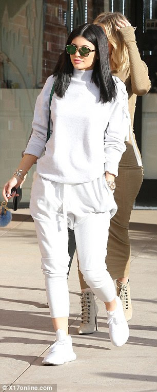 Final touches:Keeping with her sports luxe look, Kylie added a pair of white Adidas Tubular Defiant sneakers