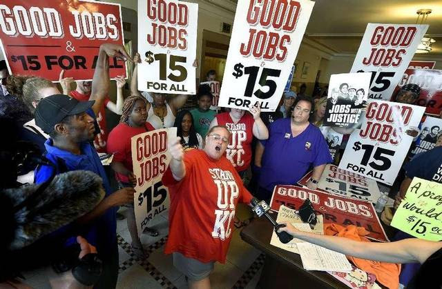 The Kansas City       Council voted in July for a minimum wage increase that calls for       $13 per hour by 2020. After the vote, Dana Wittman of Stand Up KC       led the cheers just outside the council chambers.
