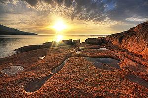 Sunset at Honeymoon Bay, Freycinet Peninsula, ...