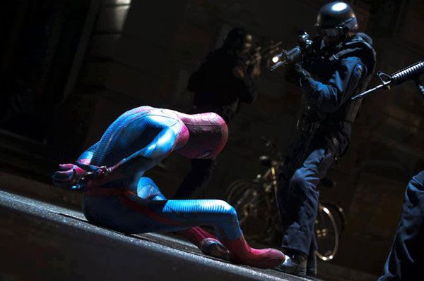 Spidey (Andrew Garfield) is confronted by SWAT team members in THE AMAZING SPIDER-MAN.