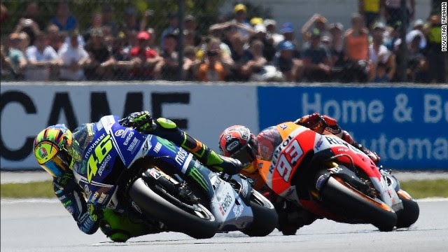 """Introducing """"The Doctor"""" of MotoGP -- Valentino Rossi briefly leads Marc Marquez at the French MotoGP on 18 May 2014."""