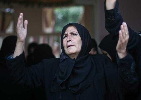 A relative of Hamas militant Suliman al-Garah mourns during his funeral in Khan Younis, southern Gaza Strip, 28 October 2012. An Israeli air strike killed the Hamas militant, accused of preparing to fire a rocket from the Gaza Strip into Israel. EFE/EPA/ALI ALI