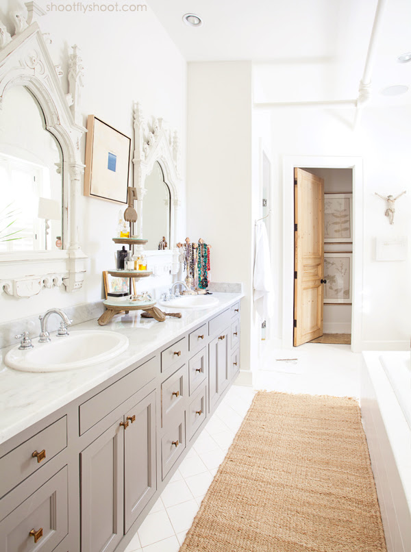 Atchison Home | White Bathroom | Gray Vanity | Antique Mirrors